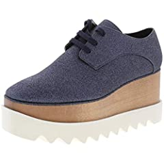 These Womens Stella McCartney Elyse Oxfords are guaranteed authentic. They're crafted with Man Made, and the closure is . The heel height is inches, the size is 38 Medium (B,M), and the color is Deep Blue.