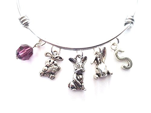 - Rabbit themed personalized bangle bracelet. Antique silver charms and a genuine Swarovski birthstone colored element.