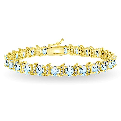 Bracelets Gold Tennis Gemstone (GemStar USA Yellow Gold Flashed Sterling Silver Blue Topaz 6x4mm Oval and S Tennis Bracelet with White Topaz Accents)