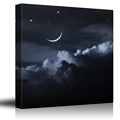 Crescent Moon and Stars Above Dark Clouds