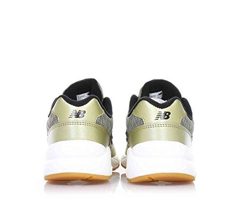 NEW BALANCE - Goldene Sportschuhe mit Schnürsenkel, aus Leder und Stoff, seitlich ein Logo, sichtbare Nähte und Gummisohle, Jungen