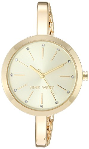 - Nine West Women's Quartz Metal and Alloy Dress Watch, Color:Gold-Toned