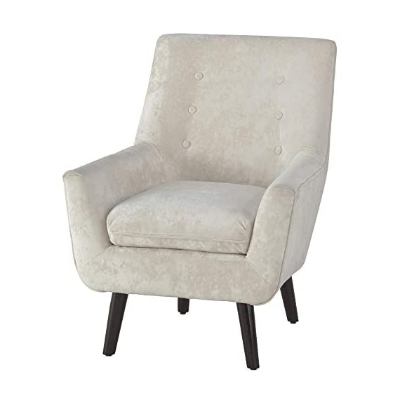 Signature Design by Ashley - Zossen Accent Chair - Contemporary Style - Ivory - Tufted Back - IVORY ACCENT CHAIR: Breathe new life into your space with the timeless styling of this arm chair. The sleek armrests, tapered faux wood legs and button tufting add that classy, retro chic touch HANDSOMELY CRAFTED: Sit back and relax on the high-resiliency foam cushions wrapped in crushed velvet polyester upholstery. Supported by a corner blocked frame and exposed faux wooden feet MID CENTURY MODERN: This chair is proof that trends always circle back around. Inspired by core elements of mid century design, this piece makes a major comeback in a shade of easy-to-love ivory - living-room-furniture, living-room, accent-chairs - 41a8CjPL9zL. SS570  -