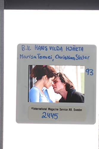 (Slides photo of Christian Slater with Marisa Tomei)