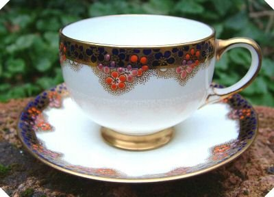 (c1914 Star China Paragon F787 Orange Blue Cup & Saucer )
