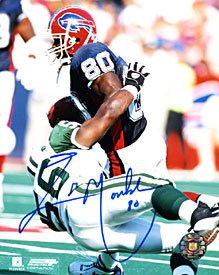 - Eric Moulds Autographed / Signed Breaking a Tackle 8x10 Photo