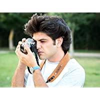 Personalized camera strap made from leather, perfect gift for photographer.