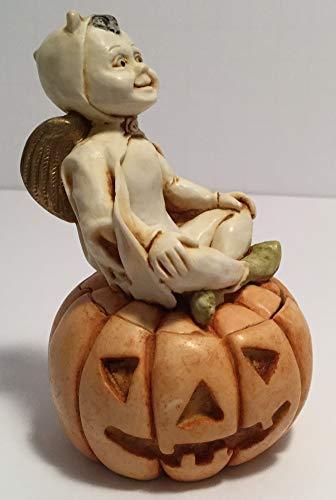 Harmony Kingdom - Pumpkinfest- A boy Angel, Dressed in a Devil's Costume for Halloween, is Sitting Cross-Legged ATOP a Jack-O-Lantern. Edition # 1 with no hallmarks. Box Figurine -