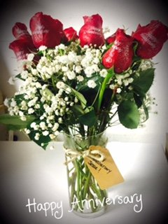 One Dozen Red Rose Bouquet Hand Embossed With The Words  Happy Anniversary