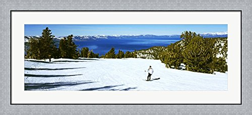 Tourist skiing in a ski resort, Heavenly Mountain Resort, Lake Tahoe, California-Nevada Border, USA by Panoramic Images Framed Art Print Wall Picture, Flat Silver Frame, 44 x 20 - Lake Tahoe Heavenly