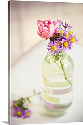 Roses and aster in glass bottle, Stockholm.