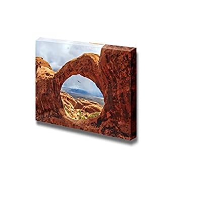 Beautiful Scenery Landscape Bird Flying Through The Top O of Double O Arch in Arches National Park Utah - Canvas Art Wall Art - 24