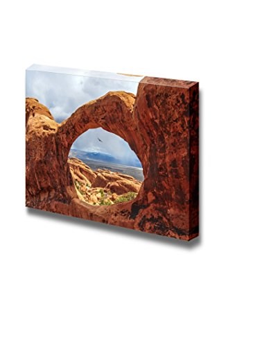Beautiful Scenery Landscape Bird Flying Through the Top O of Double O Arch in Arches National Park Utah Wall Decor ation
