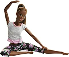 """Barbie doll is ready for a total body work-out, whether it be balancing in her tree-pose or stretching before An aerobics class! She is fab for fitness, wearing a cute gym top and stylish floral-patterned tights. With 22 """"joints"""" -In the neck..."""