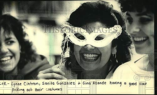 Vintage Photos 1986 Press Photo Women at Bartz Displays Try on Costumes for Halloween]()