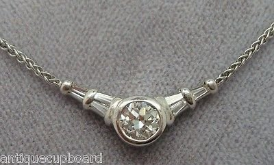 PLATINUM .65CT GENUINE NATURAL DIAMOND PENDANT (#781)