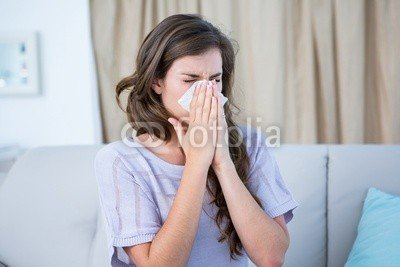 Canvas 50 x 30 cm Canvas image 50 x 30 cm   Sick woman blowing her nose , image on a Canvas