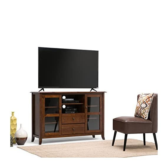 """Simpli Home Devon Solid Wood Tall TV Media Stand in Medium Mahogany Brown For TVs upto 60 inches - Hand-finished with a Medium Mahogany Brown stain and a protective NC lacquer to accentuate and highlight the grain and uniqueness of the wood Handcrafted with care using the finest quality solid pine, metal drawer glides and tempered glass Perfect for TVs up to 60"""", cord management cutouts, 1 central drawer, 1 flip down drawer, 2 doors open to adjustable shelves - tv-stands, living-room-furniture, living-room - 41c l9GkUcL. SS570  -"""