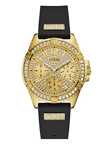 - GUESS  Comfortable Gold-Tone + Black Stain Resistant Silicone Watch with Day, Date + 24 Hour Military/Int'l Time. Color: Black (Model: U1160L1)