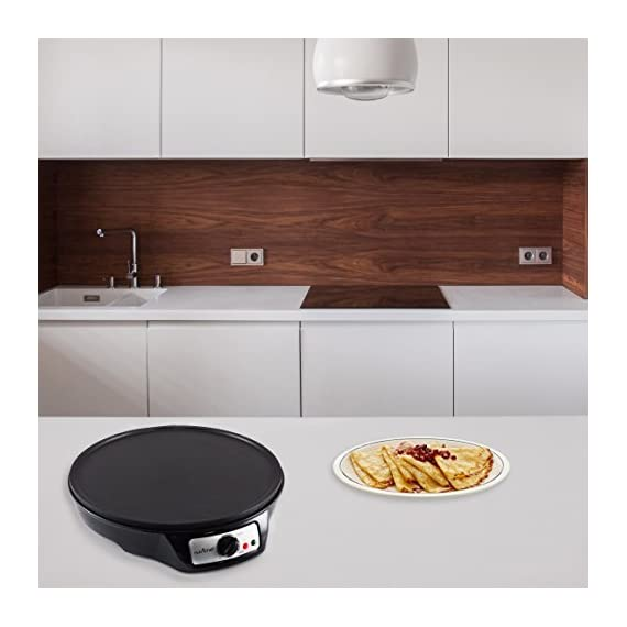 "NutriChef Electric Griddle & Crepe Maker | Nonstick 12 Inch Hot Plate Cooktop | Adjustable Temperature Control | Batter Spreader & Wooden Spatula | Used Also For Pancakes, Blintzes & Eggs (PCRM12.V7) 5 MAKE PERFECT CREPES: Concocting mouthwatering crepes and blintzes is simple with the Nutrichef Electric Griddle The 12"" inch cooking diameter is perfect for cooking traditional crepes VERSATILE COOKING TOOL: In addition to crepes, this griddle is great for making all your breakfast favorites Whip up evenly cooked pancakes, blintzes, eggs & bacon for the whole family COMPACT & CONVENIENT DESIGN: This electric hot plate is small enough to make storage & travel simple Safe for any countertop, kitchen top & table top"
