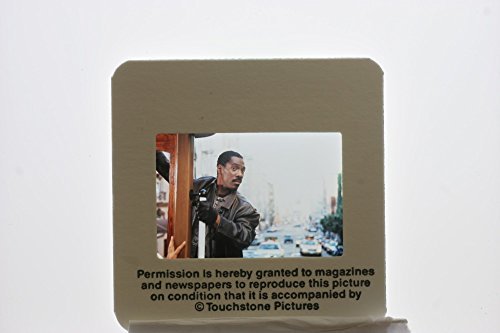 Slides photo of Eddie Murphy stars as Scott Roper in a 1997 American action comedy thriller film ,