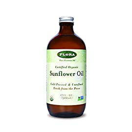 FLORA - Sunflower Oil , Cold Pressed & Unrefined, 17 Fl Oz 5 HIGH QUALITY: Our organically certified product is Non GMO, Gluten Free, vegan, and kosher. This product is sure to be an essential culinary oil in your kitchen. OUR COLD PRESS PROCESS: This unique blend begins by patiently grinding sunflower seeds with traditional presses. To maintain peak nutritional value and prevent oxidation, we don't use any heat to create an unfiltered and unrefined oil that maintains the integrity of the flavor. This unique method helps to retain the original richness while providing omega 6 and 9 HEALTHY: Each batch contains naturally occurring omega fatty acids, Vitamin E, Vitamin K, beta-carotene and antioxidants to promote healthier skin by ridding the body of acne-causing bacteria and reducing fine lines. This nutrient dense oil also helps natural hair growth and soothes skin irritations due to its anti-inflammatory properties.*