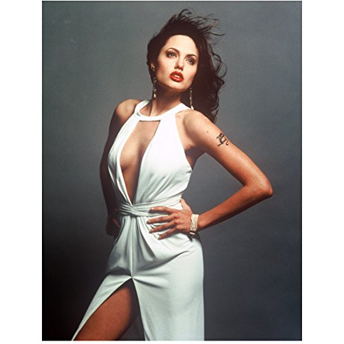 Angelina Jolie Red Lips Wearing White Dress Low Cut Pearl Bracelet Hands on Hips Looking Up to Side Wind Blown Hair 8 X 10 Inch Photo