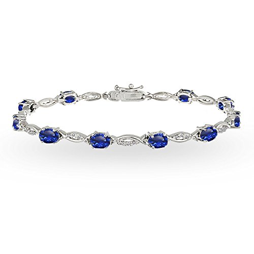 - Sterling Silver Created Blue Sapphire and White Topaz Oval-Cut Swirl Tennis Bracelet
