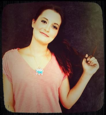 The Blue Elephant Necklace designed to securely conceal your Fitbit® Flex!