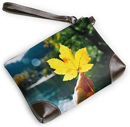 JHGFG Wristlet Handbag Hand Holds Maple Yellow Leaf on Leather Wristlet Clutch Wallet for Women Clutch Wallet for Women Smartphone Wristlet Purse