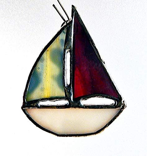 (White Stained Glass Sailboat, Red, Blue, Green, Yellow, Pink, Multi Colored combination of Sails.)