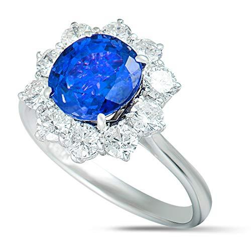 - Asprey 18K White Gold Diamond and Tanzanite Flower Ring