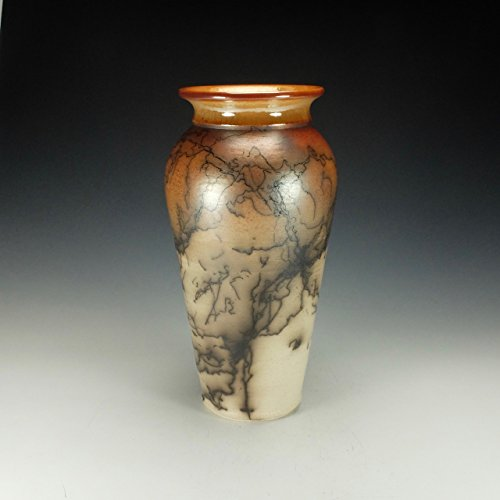 Raku horse hair pottery. Hand polished Terra Sigillata.