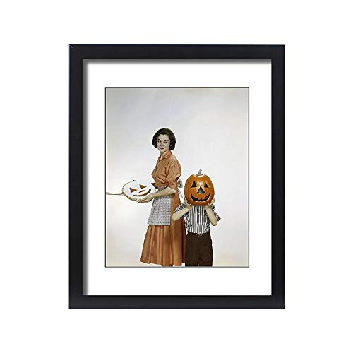 Media Storehouse Framed 20x16 Print of Woman with Pie Looking at Child Holding Halloween Pumpkin, Smiling (13262445) -
