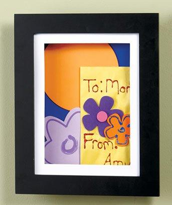 Easy Change Artwork Frame - Black - Fits 8.5'' x 11'' Artwork. Frame Measures 13.5'' x 11'' x 1 3/4''