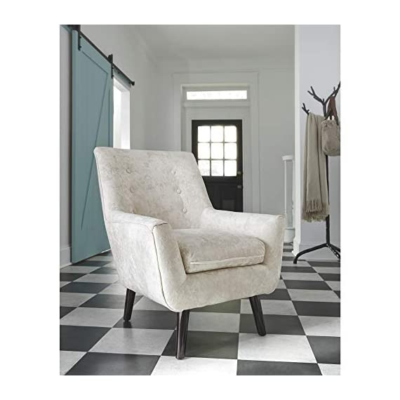 Signature Design by Ashley - Zossen Accent Chair - Contemporary Style - Ivory - Tufted Back - IVORY ACCENT CHAIR: Breathe new life into your space with the timeless styling of this arm chair. The sleek armrests, tapered faux wood legs and button tufting add that classy, retro chic touch HANDSOMELY CRAFTED: Sit back and relax on the high-resiliency foam cushions wrapped in crushed velvet polyester upholstery. Supported by a corner blocked frame and exposed faux wooden feet MID CENTURY MODERN: This chair is proof that trends always circle back around. Inspired by core elements of mid century design, this piece makes a major comeback in a shade of easy-to-love ivory - living-room-furniture, living-room, accent-chairs - 41cp5hLEFPL. SS570  -