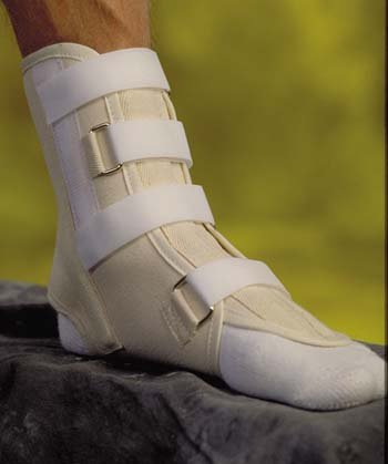 Ankle Support - Medium Cotton canvas laminated to flannel. Two medial and lateral pre-shaped aluminum stays. Two contoured tongue stays. All stays are removable. Hook & loop closure. Easy to apply and adjust. Fits right or left foot.