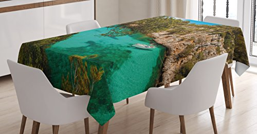 Nature Tablecloth by Ambesonne, Small Yacht Floating in Sea Majorca Spain Rocky Hills Forest Trees Scenic View, Dining Room Kitchen Rectangular Table Cover, 60 W X 84 L Inches, Green Aqua Blue by Ambesonne