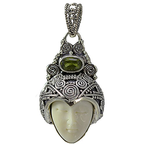 (Carved Bone Face Pendant with Peridot Stone)