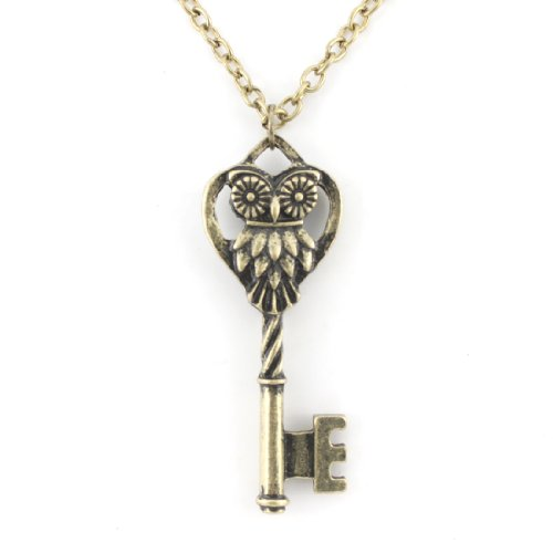 Gold Tone White Crystal Key Pendant ()