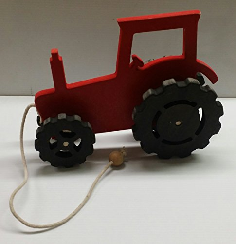 red tractor toy - 9