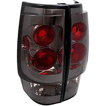 GMC ENVOY XL ALTEZZA 3D BLACK HOUSING RED LENS TAIL LIGHTS DIRECT FIT PAIR
