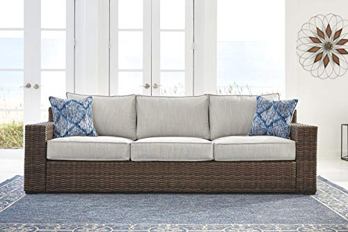 Ashley Furniture Signature Design - Alta Grande Outdoor Sofa with Cushion - Beige & Brown