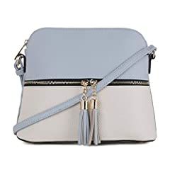 Fashion Forward Crossbody Bag! SG SUGUpresents the Crossbody Bag Collection. This purse is available in various colors. This handbag is just the right size to fit what you need for a casual night out. Go anywhere in style, this small light w...