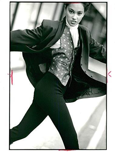 - Vintage photo of Fashion 1989,claret gaberdine frock coat with gathered shawl colar.