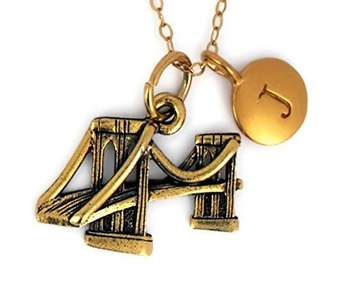 Brooklyn Bridge Charm Pendant In antique gold plated pewter personalized with a five mm 24K gold plated bronze initial charm. New York.