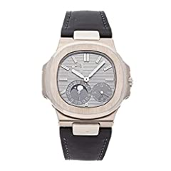 Patek Philippe Nautilus (5712G001) self-winding automatic watch features a 40mm 18k white gold case surrounding a grey dial on a brand new black rubber strap with an 18k white gold deployant buckle. Functions include hours minutes small-secon...