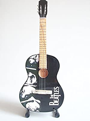 Mini guitarra de colección - Replica mini guitar - The Beatles - Tribute - TOP SELLER: Amazon.es: Juguetes y juegos