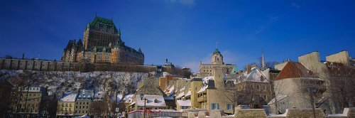 (Walls 360 Peel & Stick Wall Mural: Low Angle View of Chateau Frontenac Hotel Quebec City (48 in x 16 in))