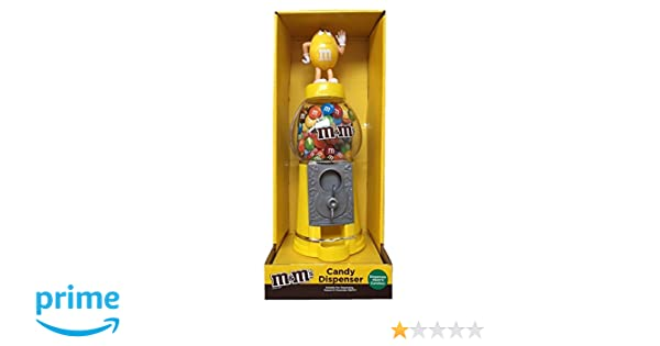 M&Ms - Dispensador de chocolate y caramelo, color amarillo, 23 cm: Amazon.es